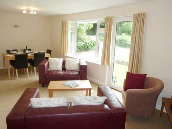 Sit back and relax in one of the comfortable living rooms at Spreacombe Gardens.