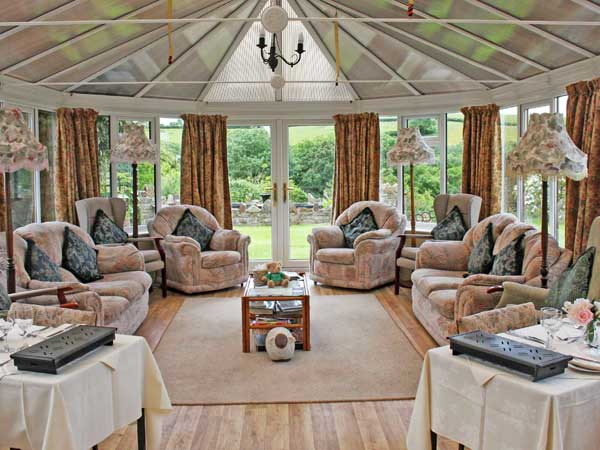 A relaxing conservatory to sit back and relax in at West Down B&B Guest House in North Devon .