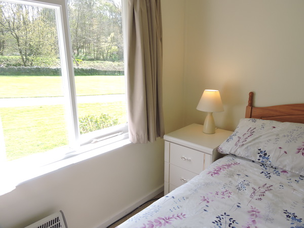 Ground floor double bed overlooking the lawn