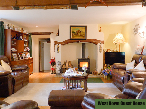 A spacious and comfortable living room to be enjoyed at West Down Guest House.