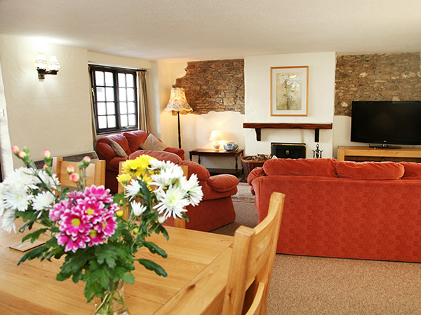 A lovely, cosy lounge at Hill Farm Cottages.
