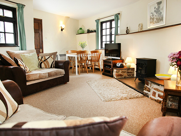 The cosy lounge at Hill Farm Cottages in their Halfpenny Bridge Cottage.