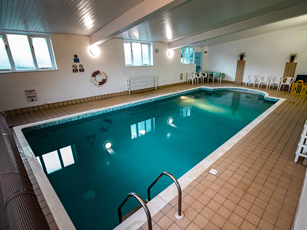 Take a dip in the indoor swimming pool at Hill Farm Cottages, North Devon.