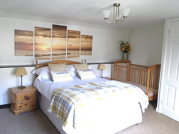 A spacious, double bedroom at Hill Farm Cottages, North Devon.