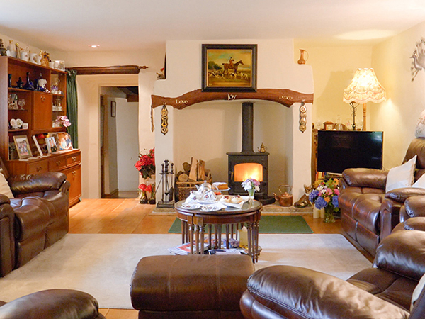 Enjoy a cosy living room while stay at West Down bed and breakfast.