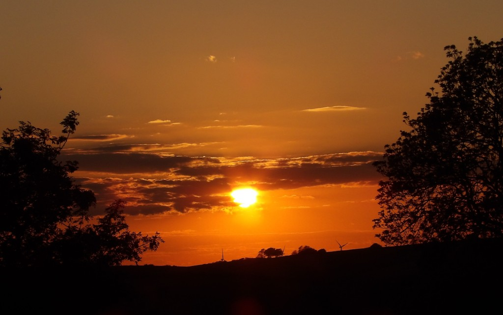 A stunning sunset in the countryside at Bampfield Farm Holidays in North Devon.