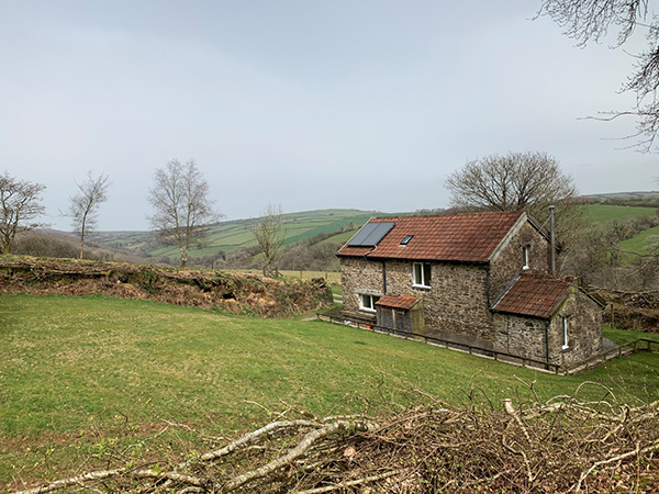 Stay in a beautiful stone farmhouse at Hollacombe Farm Self-Catering Cottage.