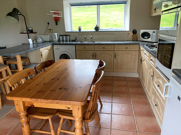 Cook up a family meal in the large kitchen at Hollacombe Farm.